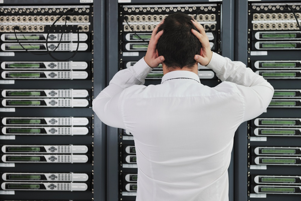 business man in network server room have problems and looking for  disaster solution.jpeg