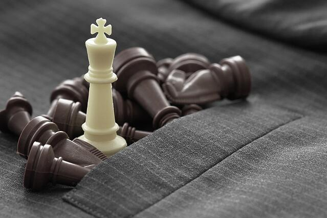 close up of chess figure on suit background strategy or leadership concept.jpeg
